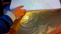 ...copying the design directly onto the sheet of brass...